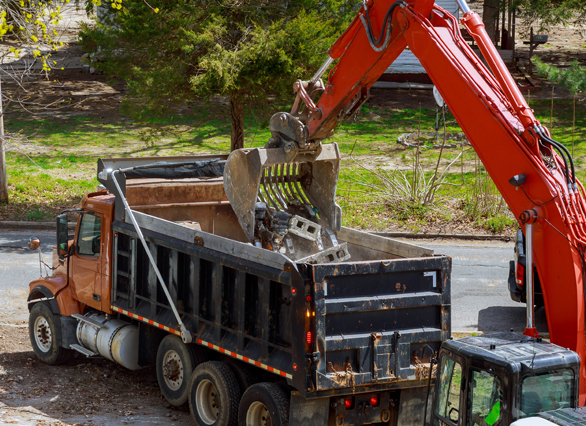 Construction waste removal using excavator and crane