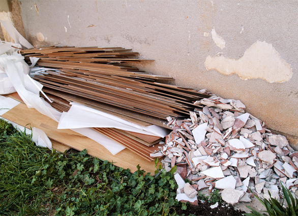 leftover construction waste tiles and boards awaiting collection